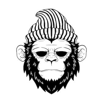 Visage ou tête de singe avec un chapeau de hipster tricoté dessin à la main ou style de croquis de tête de singe