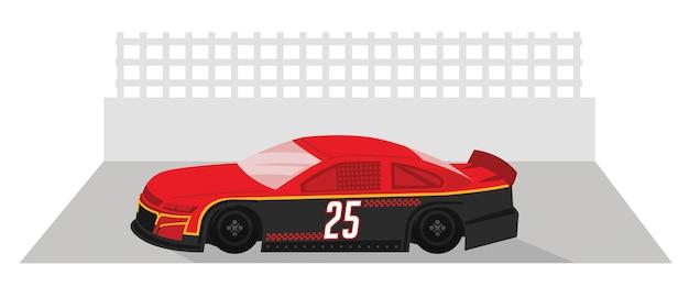 Une voiture de course rouge est prête à courir sur une piste de course