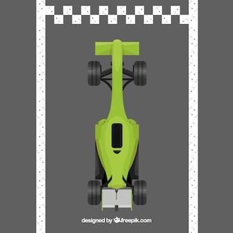 La voiture de course verte f1 franchit la ligne d'arrivée