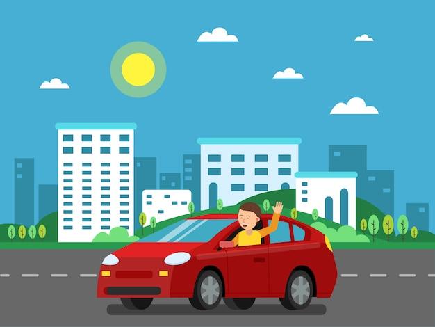 Voiture rouge sur la route dans le paysage urbain.