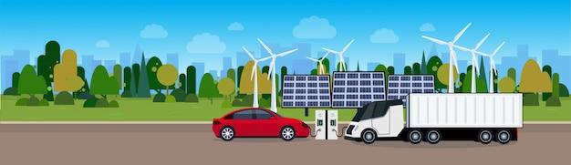 Voitures et camions électriques se rechargeant à la gare à partir de turbines à vent et de batteries de panneaux solaires concept de véhicule écologique eco friendle