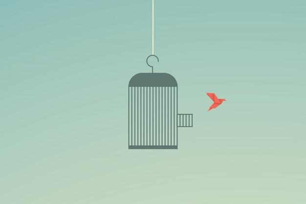 Vol d'oiseau et cage concept de liberté