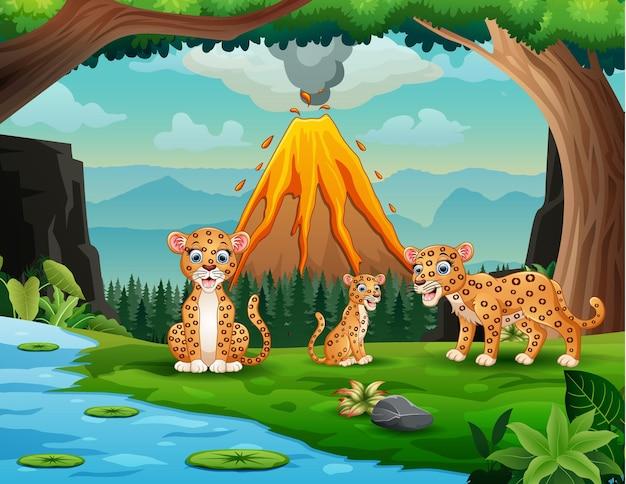 Volcan en éruption avec une famille de léopards au bord de la rivière