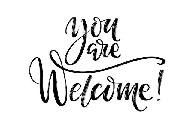 Vous êtes les bienvenus mots à la main.