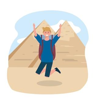 Voyage homme sautant et destination de la pyramide égyptienne