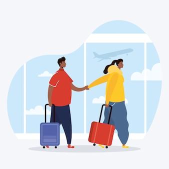 Voyageurs couple interracial avec valises