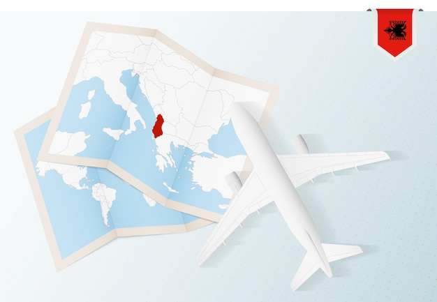 Voyagez en albanie, avion vue de dessus avec carte et drapeau de l'albanie.