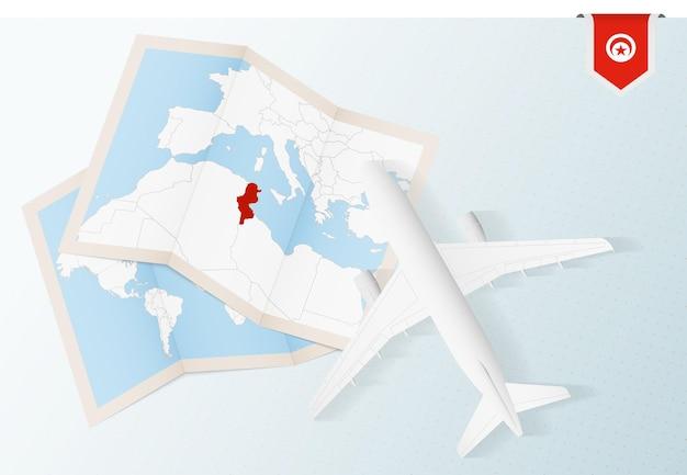 Vue de dessus avion avec carte et drapeau de la tunisie