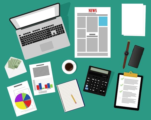 Vue de dessus d'un bureau avec un bloc-notes d'ordinateur reprend documents graphiques rapports