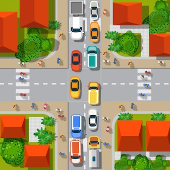 Vue de dessus du carrefour urbain avec des voitures et des maisons