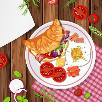 Vue de dessus du croissant avec élément alimentaire sur la table