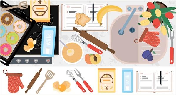 Vue de dessus du plan de travail de la cuisine avec un équipement d'évier de cuisinière et des pâtisseries prêtes à l'emploi