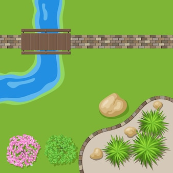 Vue de dessus jardin paysager avec chemin de pierre et pont en bois.