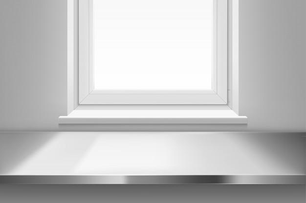 Vue de dessus de la surface de la table en acier devant la fenêtre.