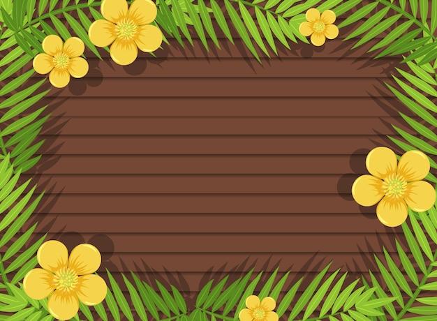 Vue de dessus de la table en bois vierge avec des feuilles et des éléments de fleurs jaunes