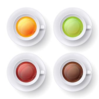 Vue de dessus de tasse de thé. tisane verte, noire et jaune dans des tasses blanches.