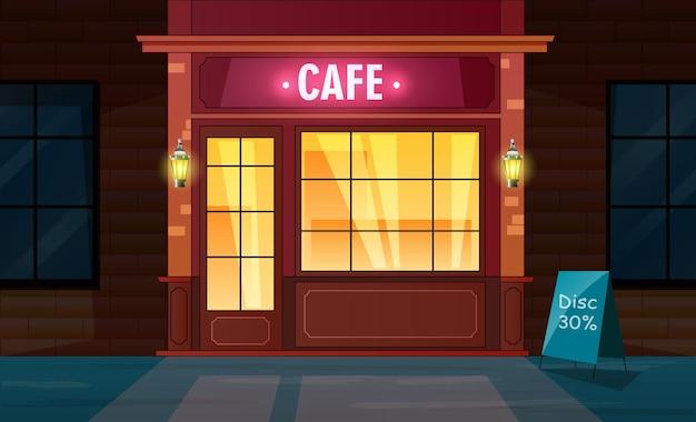 Vue de face de l'extérieur du café de nuit depuis la rue