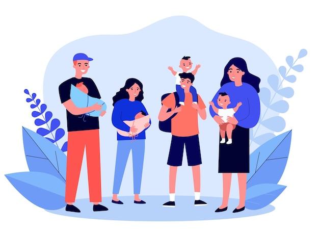 Vue de face des gens heureux avec des nourrissons debout ensemble