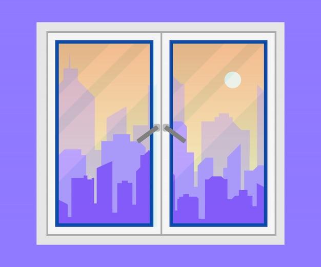 Vue sur la fenêtre et la ville.