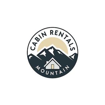 Vue sur la montagne avec cabine pour maison de village à louer logo