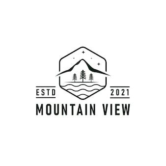 Vue sur la montagne logo emblème illustration vectorielle avec conception de silhouettes de rivière, de forêt et de montagnes