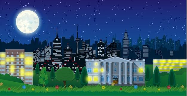 Vue sur la ville moderne dans la nuit. paysage urbain et parc