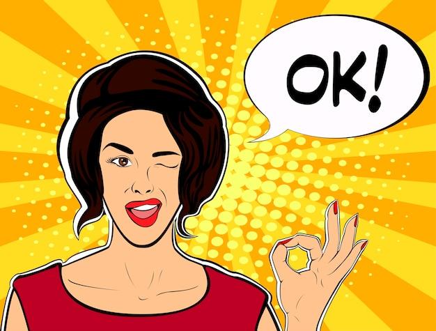 Winking girl montre ok signe avec bulle de dialogue
