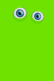 Yeux sur fond vert