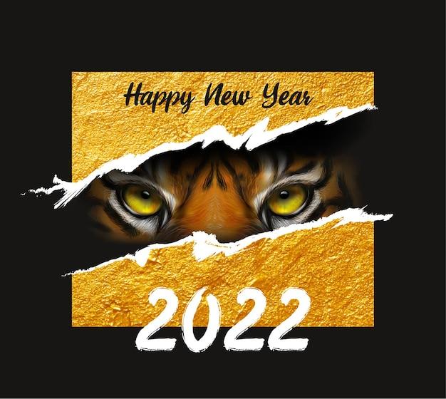 Yeux d'un tigre sur un tigre de fond noir le symbole de la nouvelle année