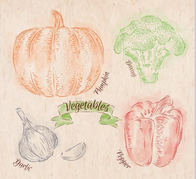 Ylégumes peints de différentes couleurs dans un style campagnard au poivre, citrouille, ail, brocoli