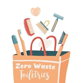 Zéro déchet, produits de base pour un mode de vie écologique, y compris une brosse à dents en bambou pour le corps, un peigne pour rasoir, des coussinets pour le visage réutilisables et un shampooing sec tombant dans un sac en papier