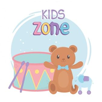 Zone enfants, tambour d'éléphant en peluche et jouets