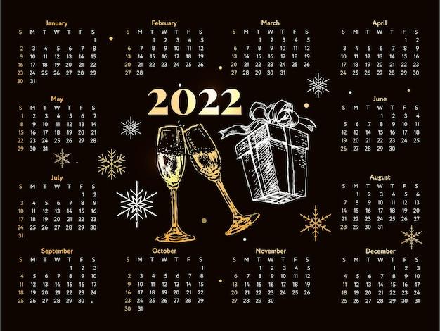 2022 navidad letras calendario de bosquejo de año nuevo dorado la semana comienza el domingo.