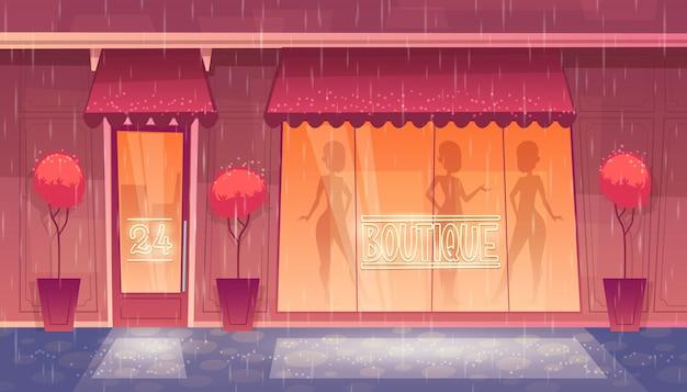 24 horas, boutique abierta las 24 horas con escaparate, mercado de ropa por la noche.