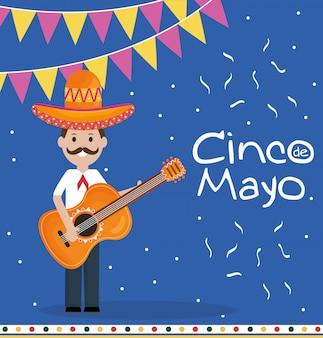 5 de mayo celebración con hombre tocando guitarra.