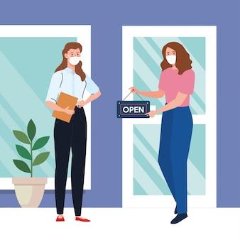 Abierto nuevamente después de la cuarentena, mujeres con etiqueta de reapertura de la tienda, estamos abiertos nuevamente, fachada de la tienda