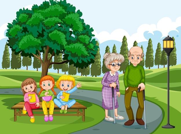 Abuelo y abuela en el parque con muchos niños.