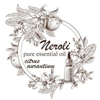 Aceite esencial grabado con frutos de naranja, hojas y flores.