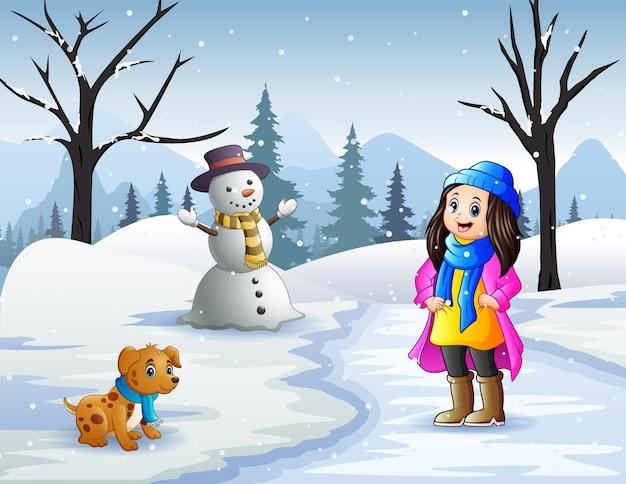 Actividades de invierno al aire libre con niña y mascotas.