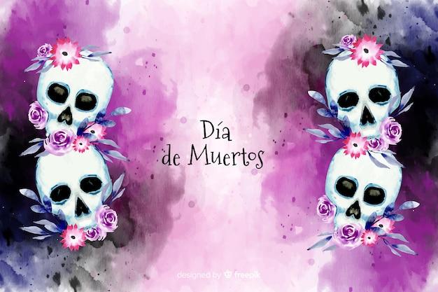 Acuarela dia de muertos con fondo floral de calaveras