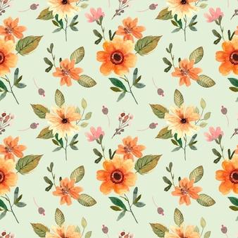Acuarela de patrones sin fisuras con flores naranjas y hojas verdes para la primavera