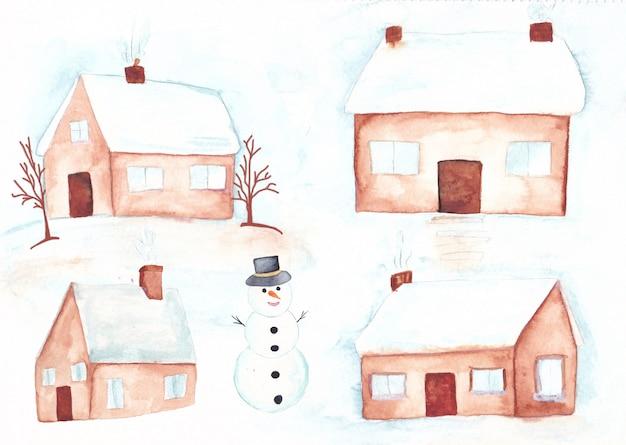 Acuarelas invernales con nieve en el techo y muñeco de nieve.