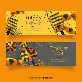 Acuarelas pancartas de halloween en tonos dorados