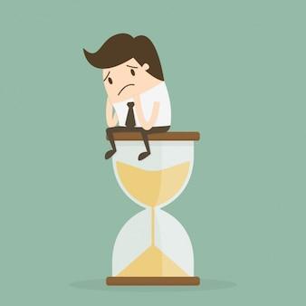 Administración de tiempo con trabajador sobre reloj de arena