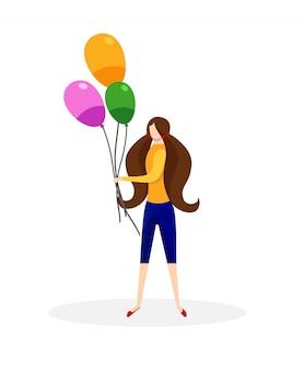 Adolescente con manojo de globos de colores.