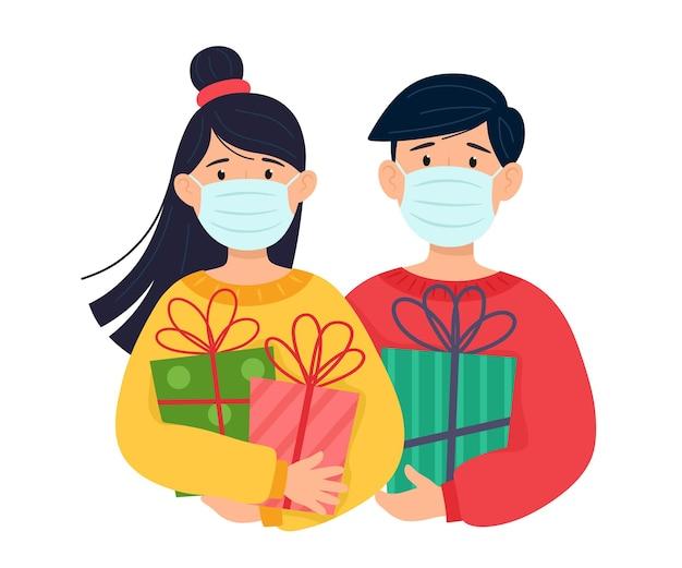 Los adolescentes con máscaras protectoras en la cara tienen regalos en sus manos