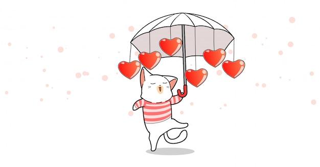 Adorable gato sostiene paraguas con corazones en el día de san valentín