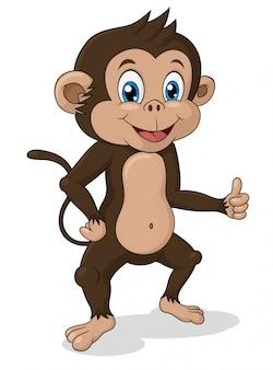 Adorable mono de pie con el pulgar arriba