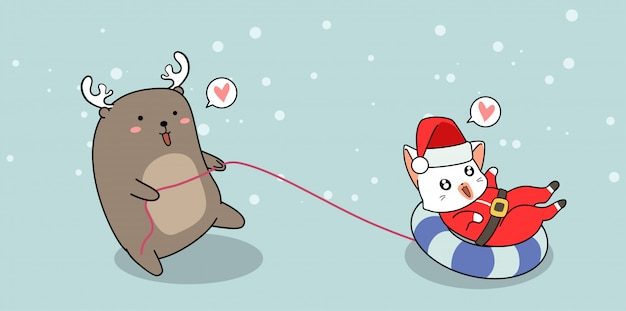 Adorable reno está arrastrando el gato de santa