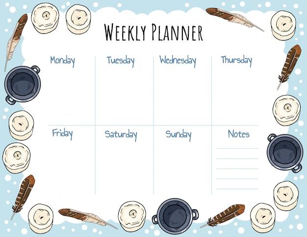 Adorno de velas, plumas y calderos para planificador semanal